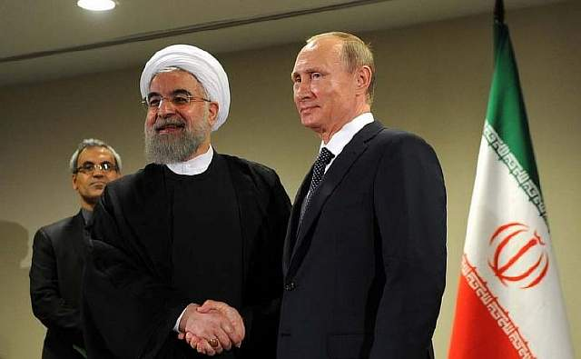 Vladimir-Putin-met-with-President-of-the-Islamic-Republic-of-Iran-Hassan-Rouhani-696x430
