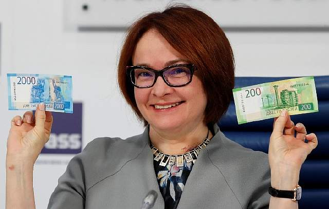 Russian Central Bank Governor Elvira Nabiullina reacts while presenting the new 200 and 2,000 rouble banknotes in Moscow, Russia October 12, 2017. REUTERS/Grigory Dukor