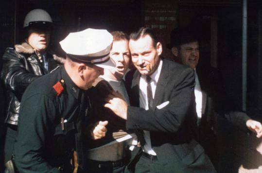 Oswald-being-led-from-the-Texas-Theatre-following-his-arrest