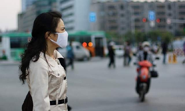 woman-wearing-a-face-mask_MEDIUM-1-960x576-1516249170