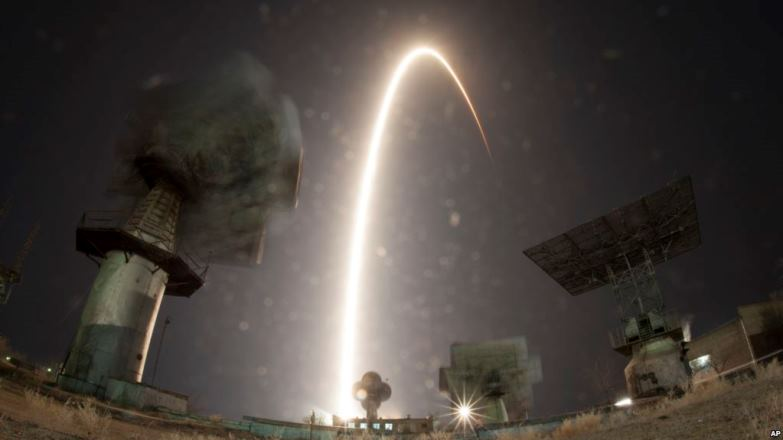 In this photo taken with long time exposure the Soyuz-FG rocket booster with Soyuz MS-08 space ship carrying a new crew to the International Space Station, ISS, blasts off at the Russian leased Baikonur cosmodrome, Kazakhstan, Wednesday, March 21, 2018. The Russian rocket carries Russian cosmonaut Oleg Artemyev, U.S. astronauts Richard Arnold and Andrew Feustel. (AP Photo/Dmitri Lovetsky)
