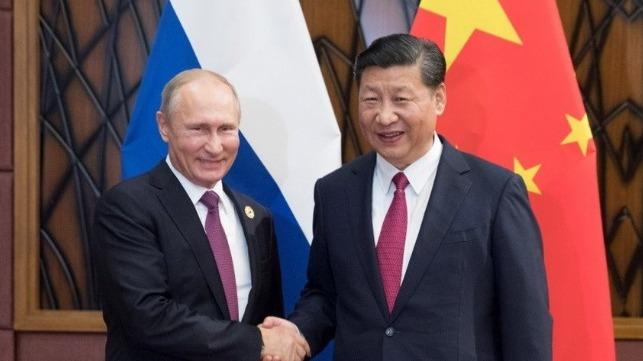 xi-and-putin-handshake.d917c9