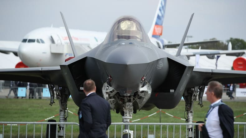 visitors-walk-past-a-lockheed-martin-f-3