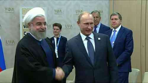 2015-07-09T153430Z_1_LOP000H5PS5K0_RTRMADP_BASEIMAGE-960X540_IRAN-NUCLEAR-ROUHANI-PUTIN-ROUGH-CUT